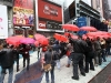 a-125-person-flash-mob-carrying-umbrellas-onducted-a-karaoke-sing-along-to-arbys-restaurant-groups-new-ad-times-square