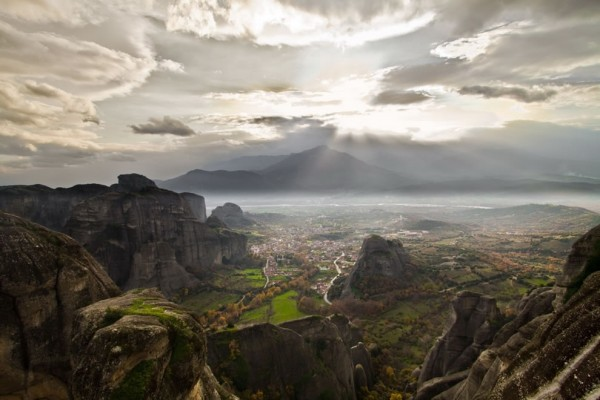 Meteora and the village of Kastraki with misty background. Photo by NickChino