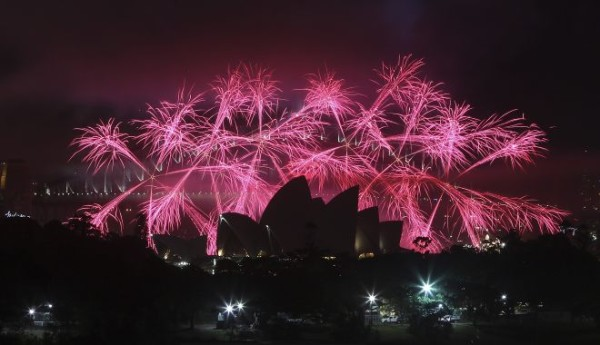 Fireworks explode behind the Opera House during the New Year celebrations in Sydney, Australia.