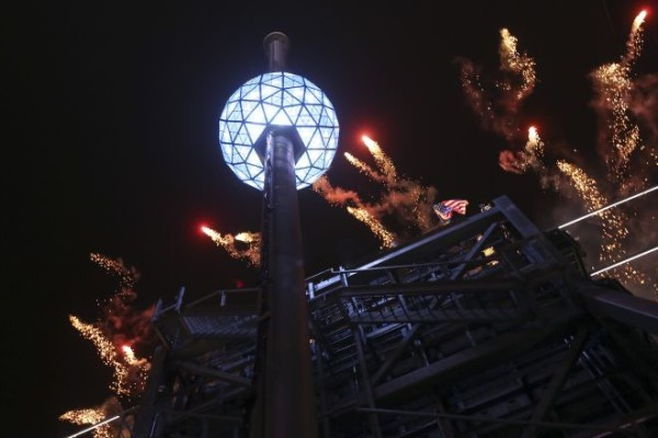 The fireworks explode as the Waterford crystal ball is raised at the beginning of Times Square New Year's celebration.