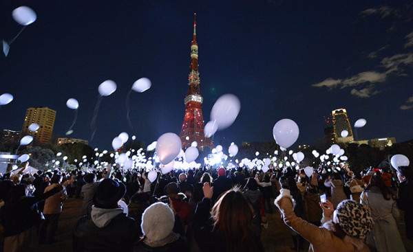 Revellers release balloons during the countdown at the Prince Park Tower in Tokyo, Japan. Photograph: Kazuhiro Nogi/AFP/Getty Images